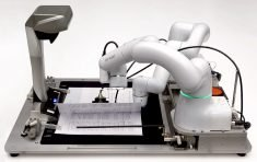 Robotics solution stamps hanko and signs contracts in Japan
